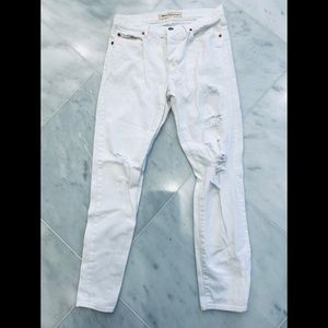 NWOT Distressed white relaxed boyfriend jeans.